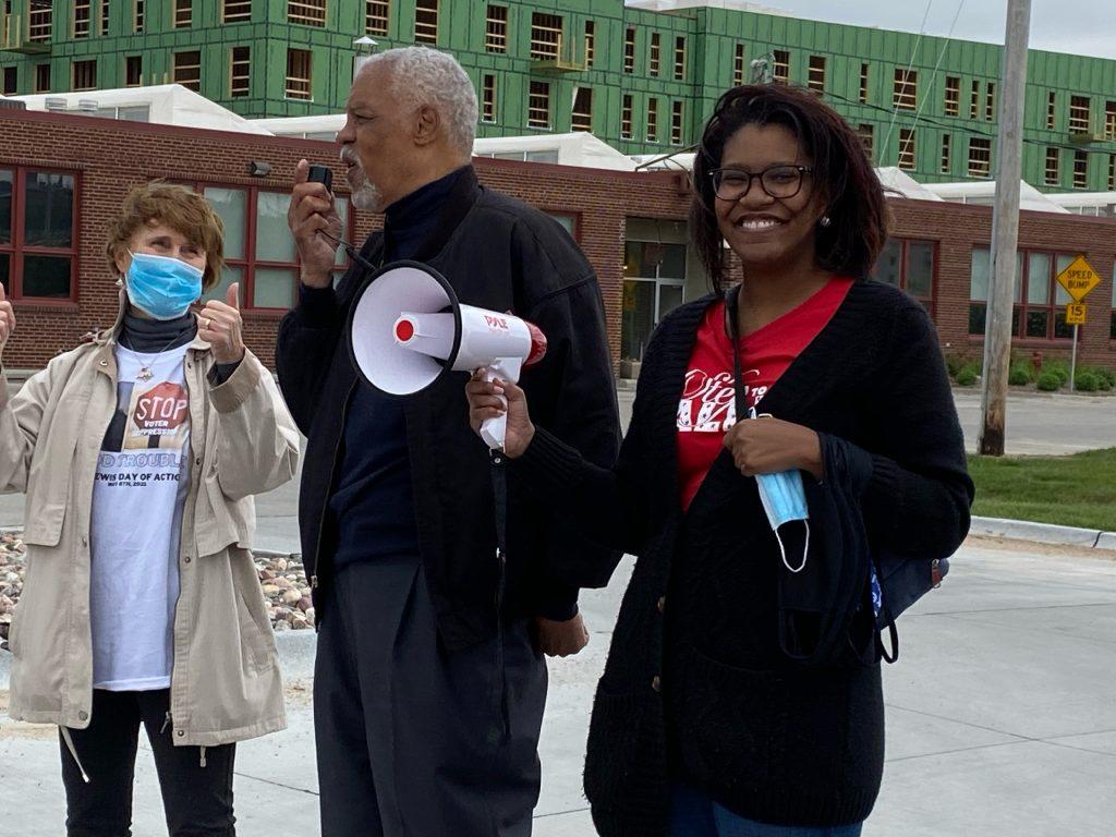 Krystal Fox, Co-President of LWVGO, Preston Love of Black Votes Matter & Joanna Lindberg of LWVGO address crowd at John Lewis Day of Action